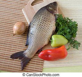 Carp fish close-up on chopping board