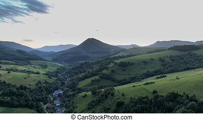 Carpathians in the evening. Shooting from the drone. 4K...