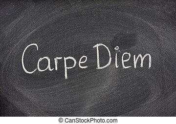 Carpe Diem phrase on blackboard - Enjoy life before it\\\'s...