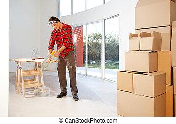Carpenter - A finishing carpenter cutting wood in a house