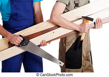 Carpenter and a builder - Carpenter with builder working...