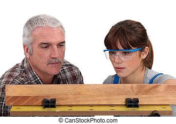 Carpenter and female apprentice