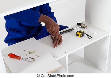 carpenter assembly furniture closeup