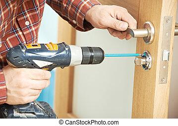 carpenter at door lock installation - carpenter at lock...