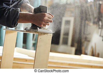 Carpenter at work - Carpenter working on a piece of...