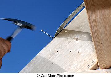 Carpenter at work - Hand and hammer of a carpenter at work, ...