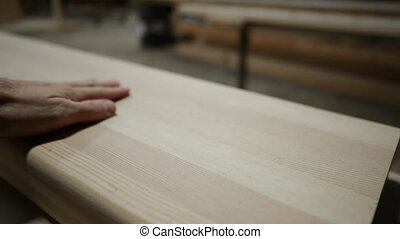Carpenter at work in woodshop - Close up of a hand of ...