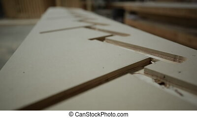 Carpenter at work in woodshop - Close up of two pieces of ...