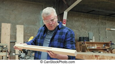 Carpenter at work in woodshop - Front view close up of a ...