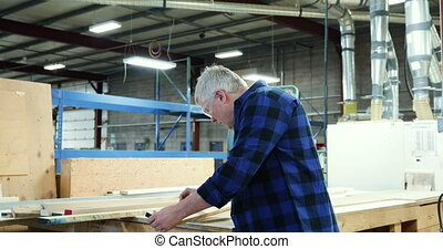 Carpenter at work in woodshop - Portrait of a smiling ...