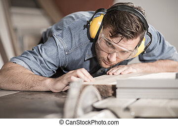 Carpenter at work with wood