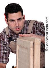 Carpenter building a cupboard