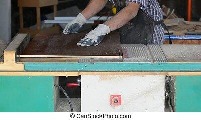 carpenter. carpenter job. cut parts for furniture. flake board cutting. chipboard edge. flake board production. chipboard factory.