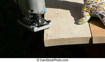 carpenter cut wooden plank