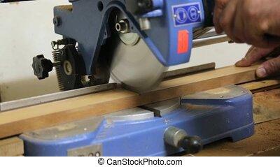 Carpenter Cutting Wood - Carpenter cutting wooden floor by...