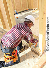 Carpenter doing the doorway.