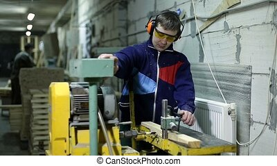 Carpenter drilling holes in dash with bench drill - Joiner...