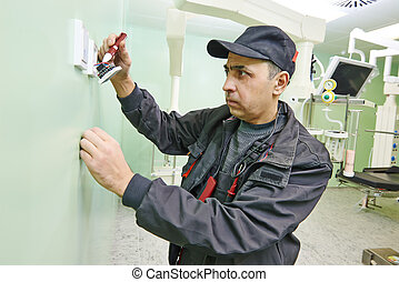 carpenter electrician with screwdriver - Carpenter joiner...