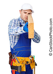 Carpenter examining a piece of wood