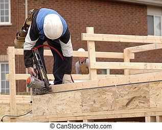 Carpenter framing a new home.