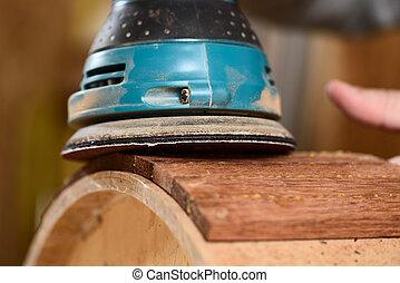 Carpenter grinding merbau wood shell for handmade drum