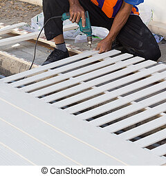 carpenter hands using electric drill on wood