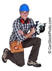Carpenter holding circular saw