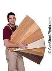 Carpenter holding plywood