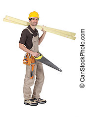 carpenter holding saw and planks