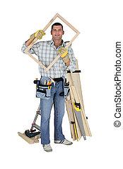 Carpenter holding wooden frame