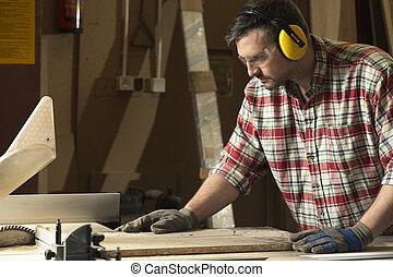 Carpenter in his temple of wood