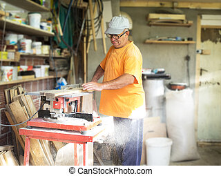 Carpenter in his workshop