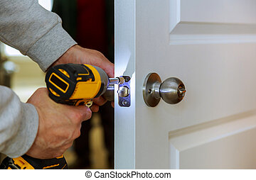 Carpenter Install Door Lock Using Screwdriver At Home