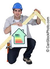 Carpenter kneeling with energy efficiency banner