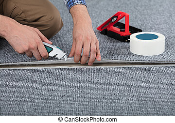 Carpenter Laying Carpet