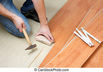 laying laminate floor - Carpenter laying laminate floor