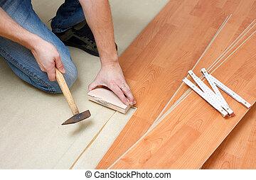 laying laminate floor - Carpenter laying laminate floor
