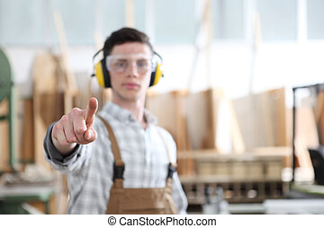 carpenter man touch screen on carpentry background