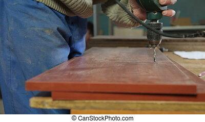 Carpenter manufacturing furniture
