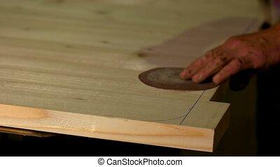 Carpenter marking measurements. Carpenter marking wooden ...