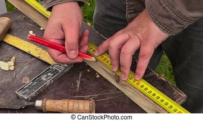Carpenter measured wooden plank