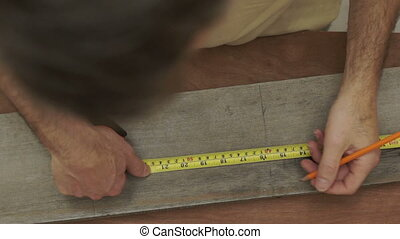 Carpenter Measuring Wood Overhead - Close up overhead shot...