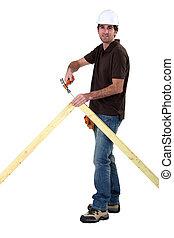 Carpenter nailing an apex