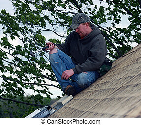 carpenter on a house roof