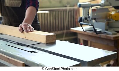 Carpenter planed wooden block with electric machine