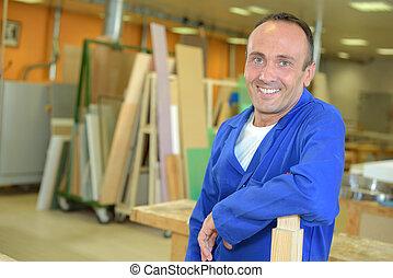 carpenter posing in workshop