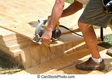Carpenter Power Saw - Sawdust fills the air as a carpenter ...