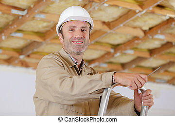 carpenter ready for work on a ladder