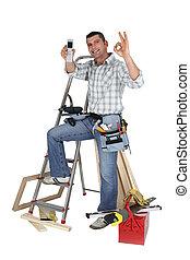 Carpenter receiving the all-clear via telephone