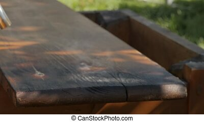 carpenter restoring old furniture. cleaning from old paint...